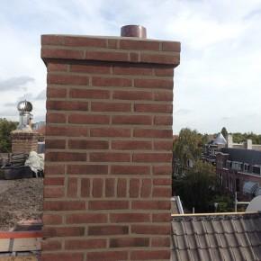 Nieuwe schoorsteen opgemetseld zoals in het bestaande metselverband.