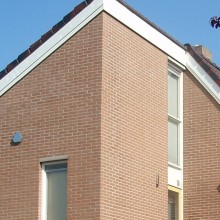 Platvol gladde voeg bij een gevelrenovatie in Rotterdam.